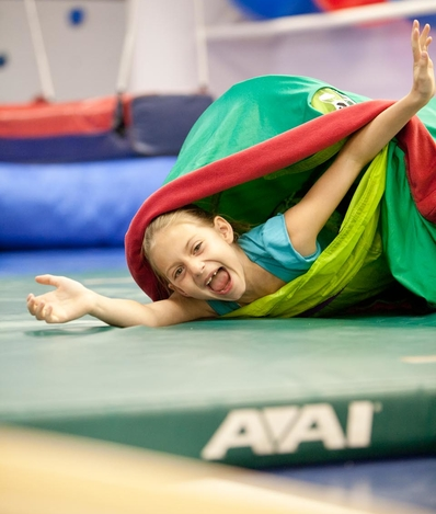 Child playing in gym and happy during treatment